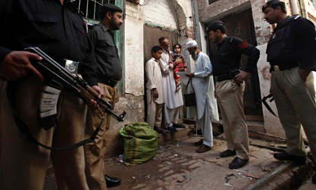 A polio worker brings vaccine drops to children in Peshawar, Pakistan. Using health initiatives as a cover for foreign policy can create suspicion of aid workers. Photograph: Fayaz Aziz/Reuters