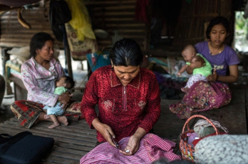 A woman prepared medicine for her mother in Roka, western Cambodia, a farming village where more than 200 people have tested positive for HIV.