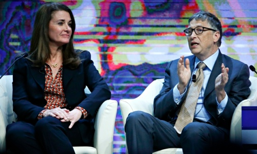 Bill and Melinda Gates speak at Davos. Photograph: Ruben Sprich/Reuters