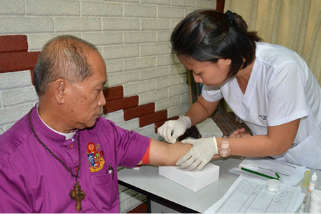 The Most Revd Ephraim S Fajutagana, Supreme Bishop of the Philippine Independent Church, undergoes an HIV test as part of the National Council of Churches in the Philippines public campaign to remove the stigma associated with HIV/Aids.