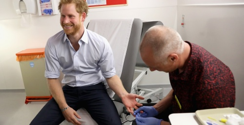 LONDON, ENGLAND - JULY 14:  Prince Harry has blood taken by Specialist Psychotherapist Robert Palmer as he takes an HIV test during a visit to Burrell Street Sexual Health Clinic on July 14, 2016 in London, England. Prince Harry was visiting the clinic, run by Guy's and St Thomas NHS Foundation to promote the importance of getting tested for HIV and other STDs.  (Photo by Chris Jackson/Getty Images)